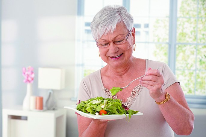 woman laughing with salad